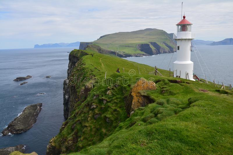 The beautiful Mykines island in The Faroe Islands. The amazing scenic landscapes that the hike to the lighthouse on Mykines island offers royalty free stock photo