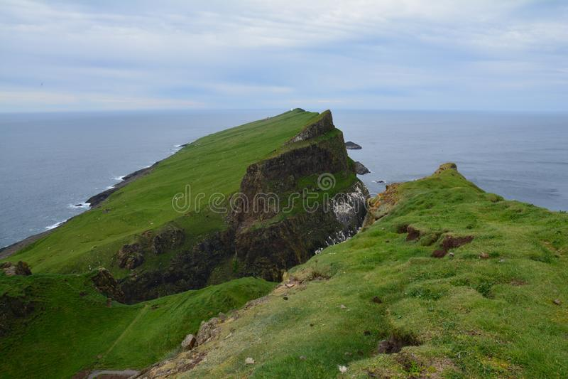The beautiful Mykines island in The Faroe Islands. The amazing scenic landscapes that the hike to the lighthouse on Mykines island offers stock photography