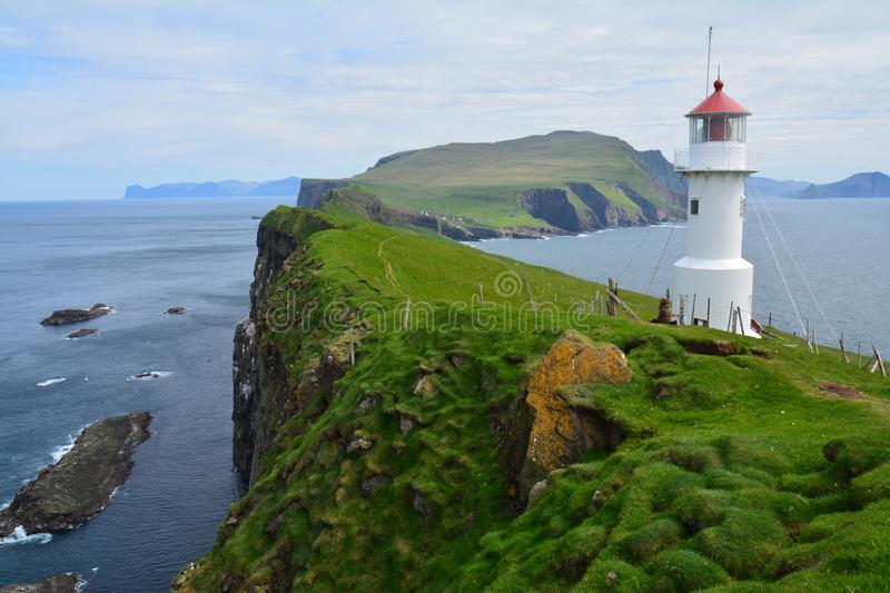 The beautiful Mykines island in The Faroe Islands. The amazing scenic landscapes that the hike to the lighthouse on Mykines island offers royalty free stock image