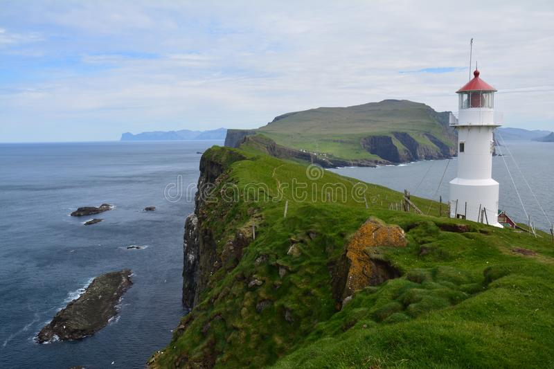 The beautiful Mykines island in The Faroe Islands. The amazing scenic landscapes that the hike to the lighthouse on Mykines island offers stock images