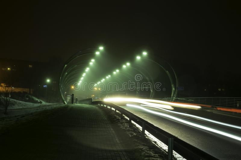 Beautiful and mysterious night landscape overlooking illuminated bridge, fuzzy and misty outline, stock images