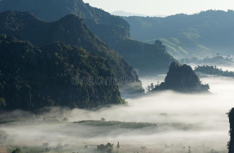 Mystic mist valley in Thailand stock photography