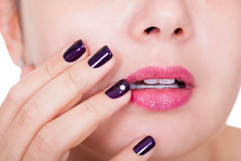 Beautiful nails and lips royalty free stock image
