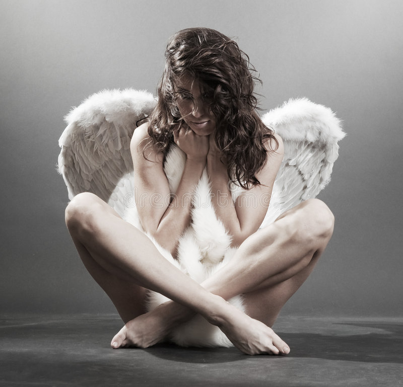 Beautiful naked angel with furs stock photo