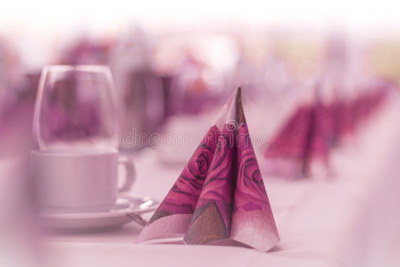 Beautiful napkins on restaurant table ready for business. High class arrangement for e.g. a wedding, birthday, business meeting or premium gala dinner stock photography