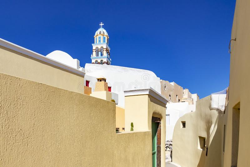 The beautiful narrow colorful streets of Emporio, Santorini, Greece with church towers where you look. The beautiful narrow and colorful streets of Emporio stock image