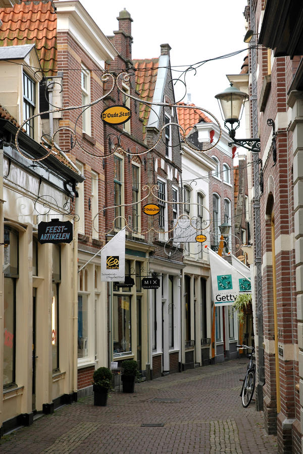 Beautiful narrow street in Alkmaar stock images