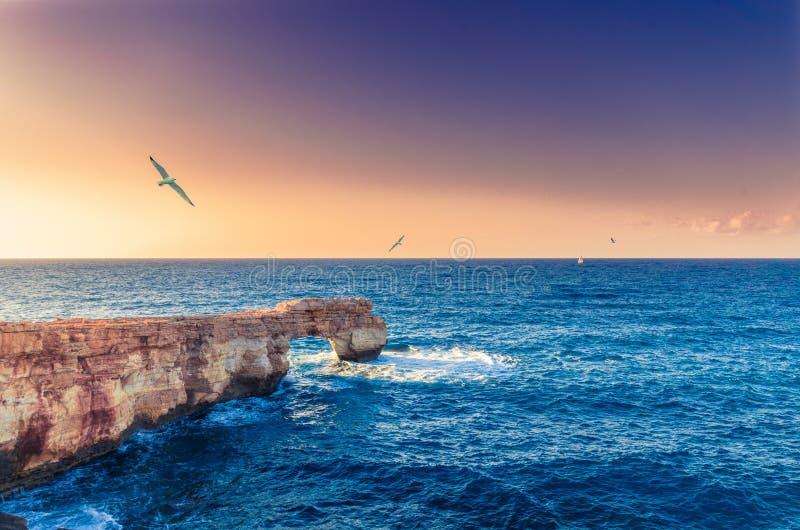 Beautiful natural big rock arch at sunset stock image