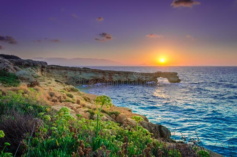 Beautiful natural big rock arch at sunset royalty free stock photo