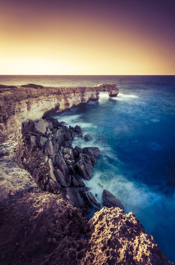 Beautiful natural big rock arch at sunset royalty free stock photos