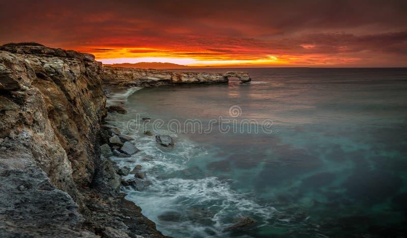 Beautiful natural big rock arch at sunset near Rethimno, Crete. stock image