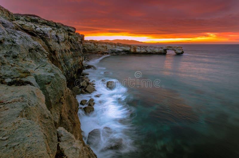 Beautiful natural big rock arch at sunset near Rethimno, Crete. stock photos