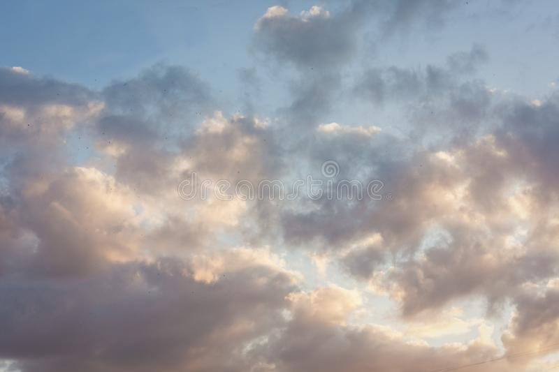 Beautiful natural blue sky background with clouds in sunny day before sunset royalty free stock photos