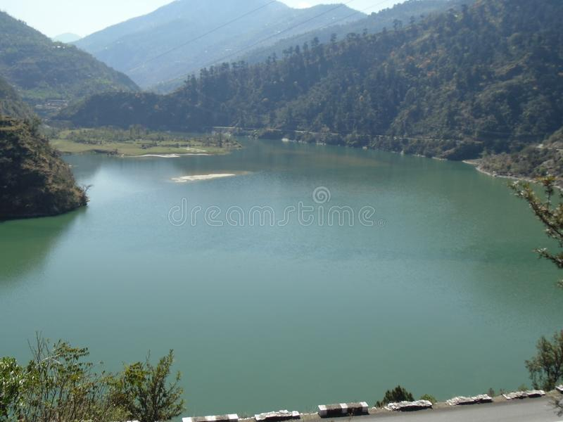 A Beautiful Natural Dam in Uttarakhand India . A Perfect Shot of a Beautiful  Natural Dam of Uttarakhand India surrounded with green Mountains .The colour of royalty free stock photography