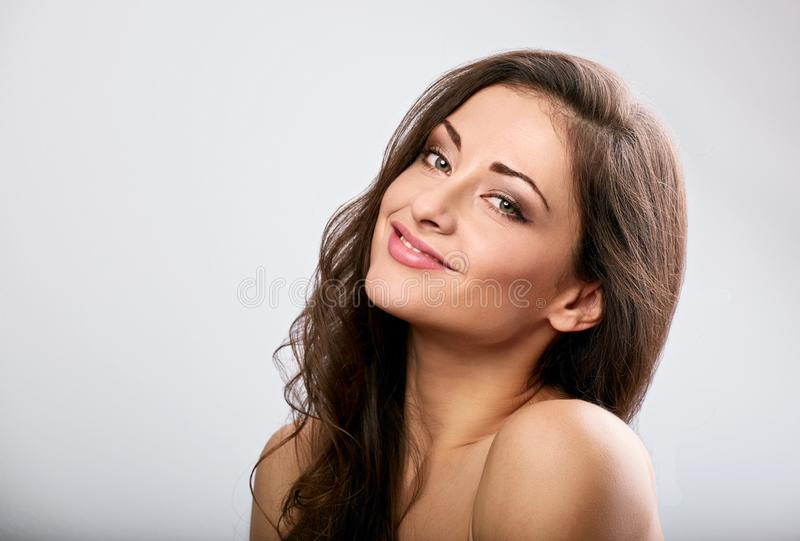 Beautiful natural makeup calm smiling woman with long hair style. Skincare concept. Closeup portrait on blue background. With empty copy space royalty free stock photos