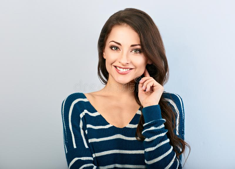 Beautiful natural makeup toothy smiling woman with long hair style. Closeup portrait royalty free stock photography