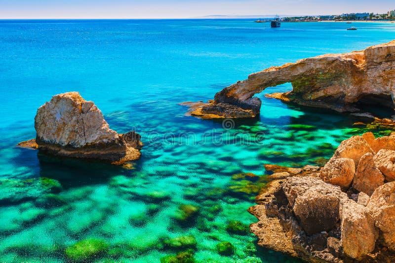Beautiful natural rock arch near of Ayia Napa, Cavo Greco and Protaras on Cyprus island, Mediterranean Sea. Legendary bridge royalty free stock images