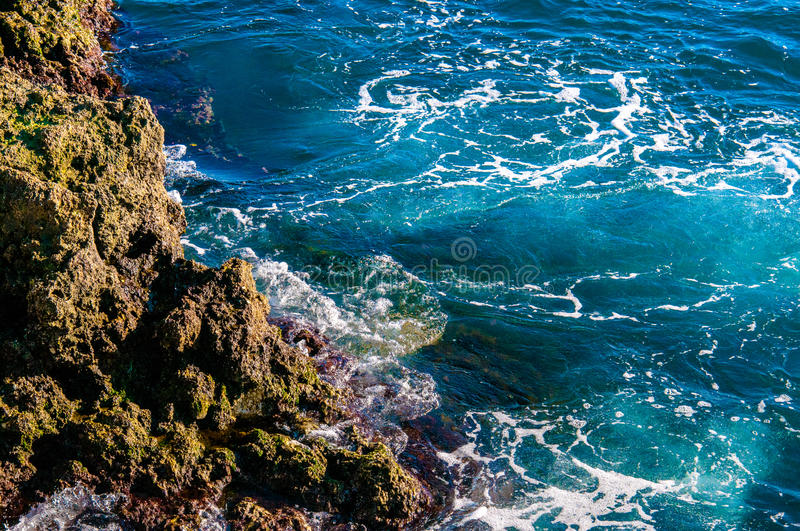 Beautiful natural rock of Australian beach. Amazing blue green sea and sunny day. Beautiful natural rock of Australian beach. Amazing blue green sea and sunny royalty free stock image