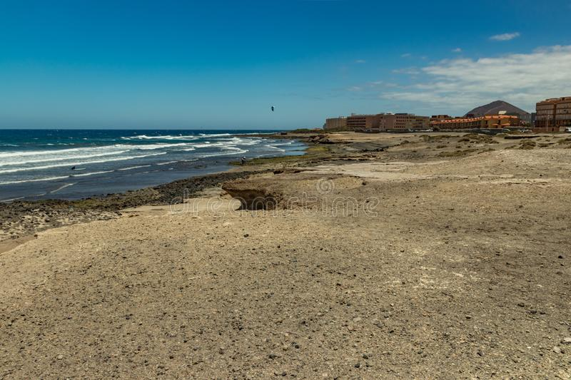 Beautiful natural southern coastline with wildlife, rocks and beaches near El Medano. Sunny day, blue sky and white fluffy clouds royalty free stock photography