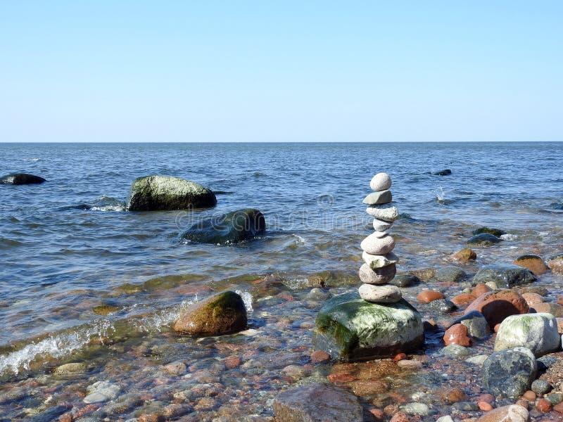 Beautiful natural stones tower on Baltic sea coast, Lithuania stock photos