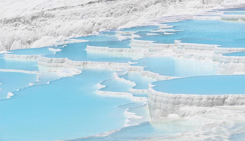 Beautiful natural travertine pools and terraces view from Pamukkale, Denizli, Turkey. Cotton castle at sunny bright day.  stock images