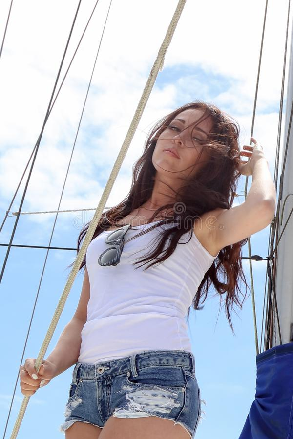 Beautiful natural Woman Girl On Sailing Yacht stock photo