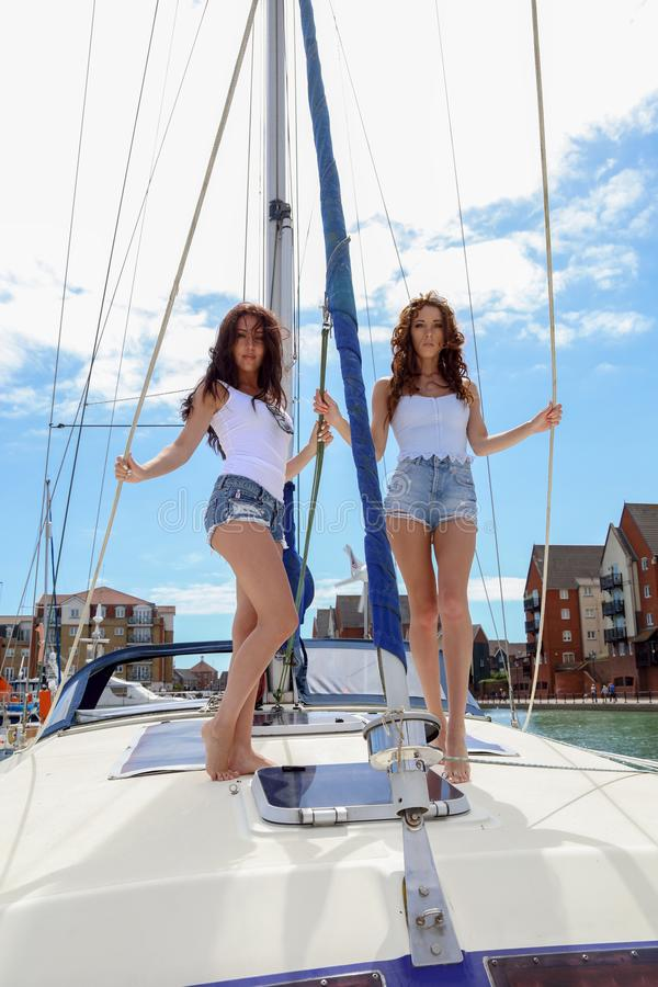 Beautiful natural Women Girls On Sailing Yacht royalty free stock photos