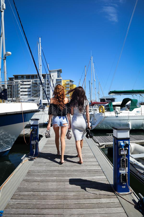 Beautiful natural Women Girls On Sailing Yacht royalty free stock photo