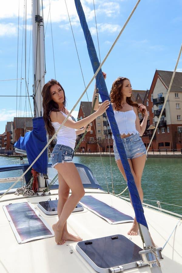 Beautiful natural Women Girls On Sailing Yacht stock photo