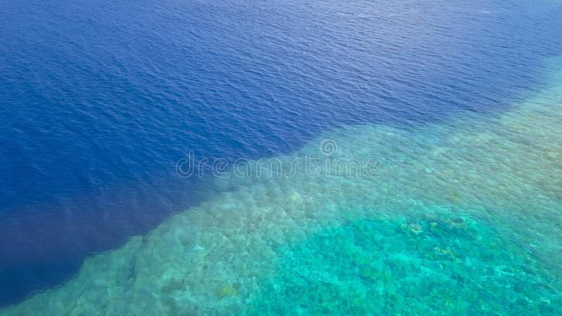 Beautiful nature of blue sea sand and Turquoise color water waves stock photography