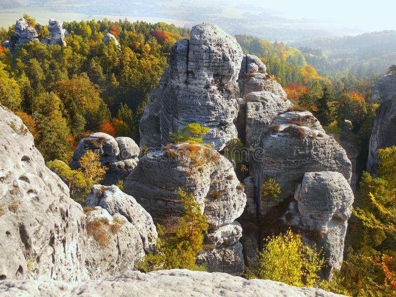 Beautiful Nature Geopark, Bohemian Paradise, Bizarre Rock Town. High bizarre sandstone rocks and forest in colorful autumnal landscape. Bohemian Paradise - a royalty free stock image