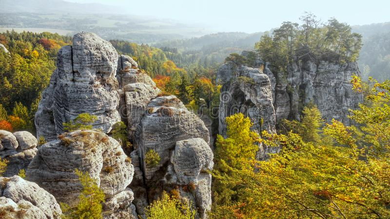 Beautiful Nature Geopark, Bohemian Paradise, Bizarre Rock Town. High bizarre sandstone rocks and forest in colorful autumnal landscape. Bohemian Paradise - a stock image