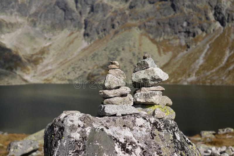 Rock towers near the lake in High Tatras Mountains. Slovakia royalty free stock images