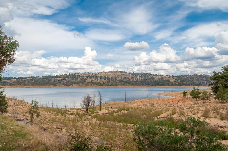 Beautiful nature landscape with blue lake, dam and tree covered hills royalty free stock photo
