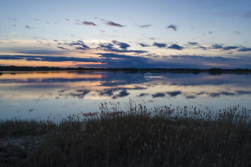 Beautiful nature and landscape photo of sunset in Katrineholm Sweden. Nice, calm and peaceful spring evening in Scandinavia. Picture shot with drone royalty free stock photos