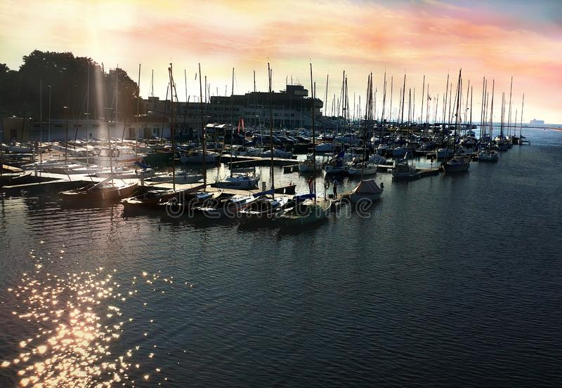 Sunset in Yachting Harbor Yachting club boat seascape evening in port Baltic Sea Estonia Tallinn sunlight  on water reflection bac. Beautiful nature seascape royalty free stock photography