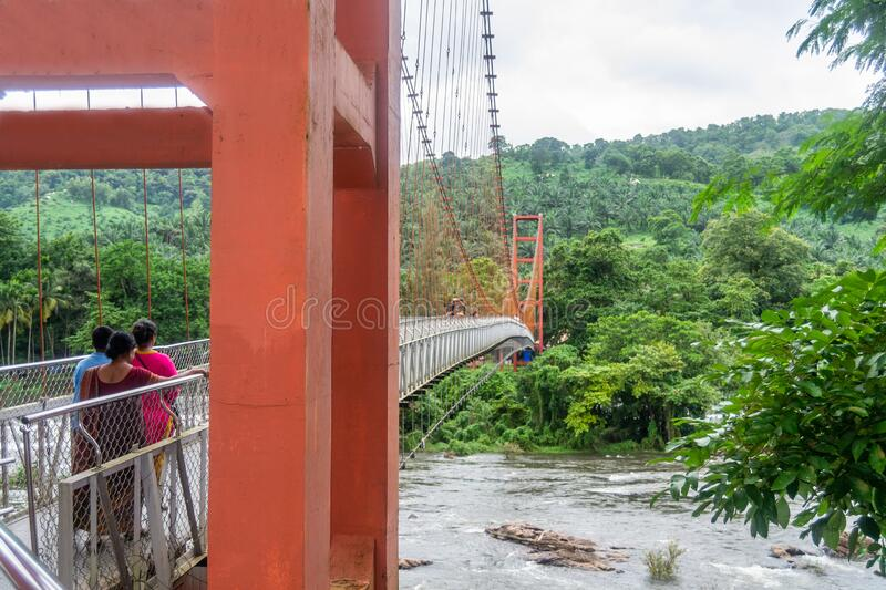 Beautiful nature view with hanging bridge during Mansoon time with full filled water fall and green forest from the famous tourist. Place in Kerala, India stock photos