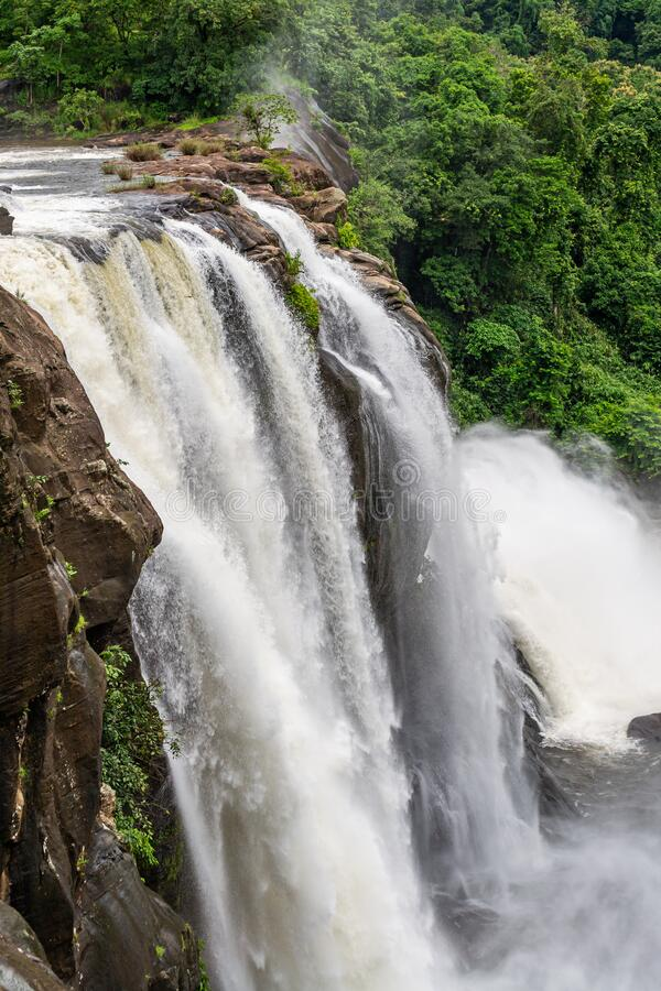Beautiful nature view during Mansoon time with full filled water fall and green forest from the famous tourist place in Kerala,. India called Athirappalli stock photography