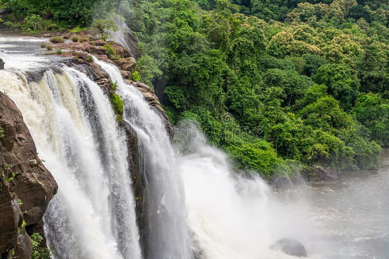 Beautiful nature view during Mansoon time with full filled water fall and green forest from the famous tourist place in Kerala,. India called Athirappalli stock image