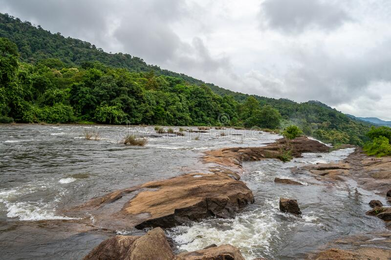Beautiful nature view during Mansoon time with full filled water fall and green forest from the famous tourist place in Kerala,. India called Athirappalli royalty free stock photography