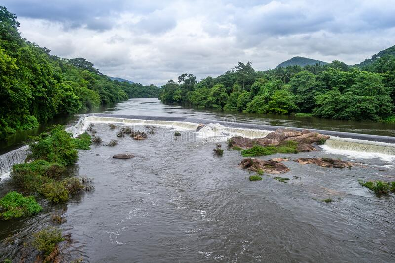 Beautiful nature view during Mansoon time with full filled water fall and green forest from the famous tourist place in Kerala,. India called Athirappalli stock photo