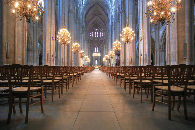 The Beautiful Nave of Cathedral Saint-Etienne in Bourges. The nave and the chandeliers of Saint-Etienne Cathedral, Bourges, Centre, France stock images