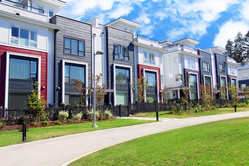 Beautiful new contempory suburban attached townhomes with colorful summer gardens in a Canadian neighborhood. stock images