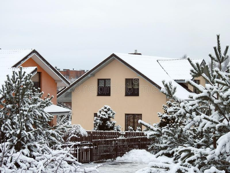Nice home and snowy trees, Lithuania royalty free stock photo