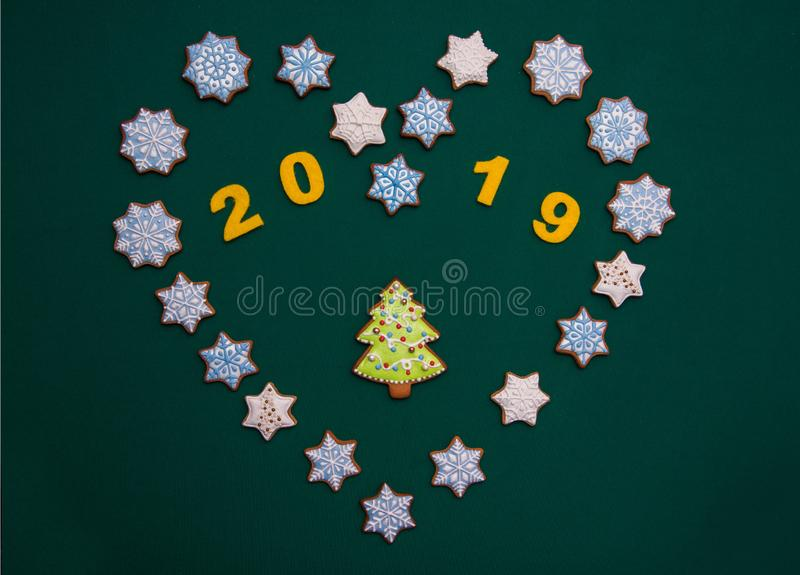 Beautiful New Year background with cookies in the form of Christmas trees, stars in the shape of the heart. Corporate Emblem. Feb stock images
