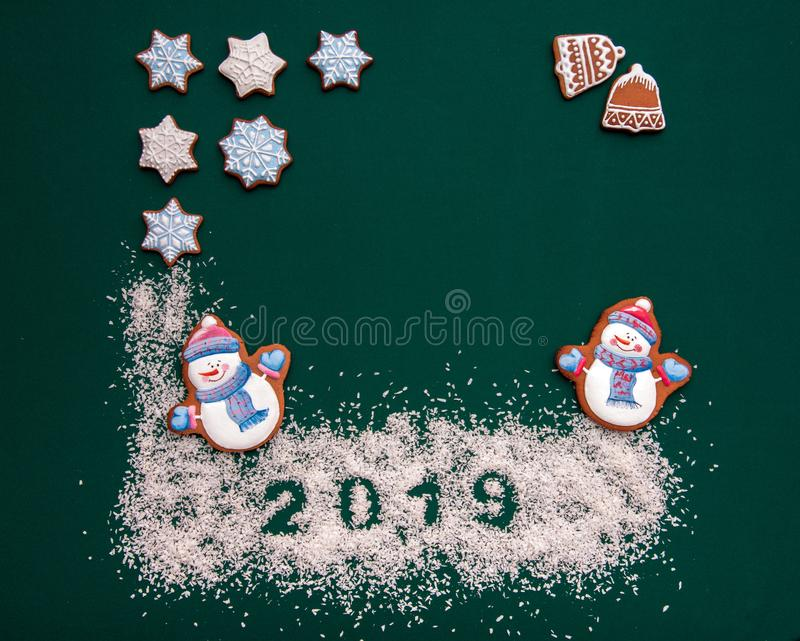 Beautiful New Year background with cup, toys and cookies in the form of a Christmas tree royalty free stock photo