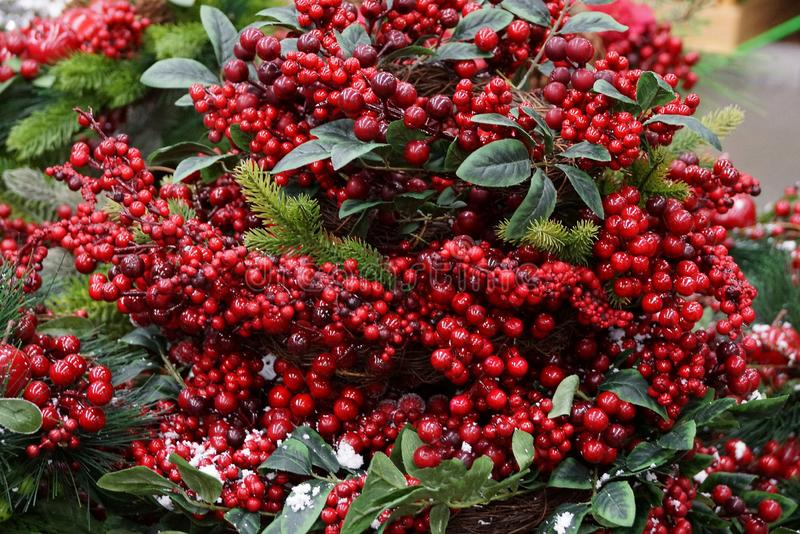 Beautiful new year wreath of red berries and green leaves stock images