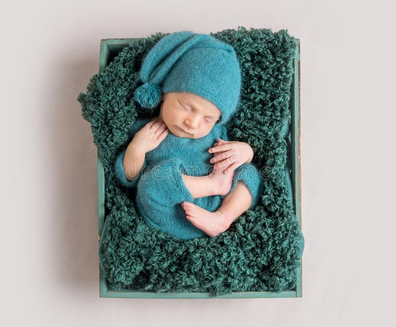 Newborn baby lying in wooden crate royalty free stock photography