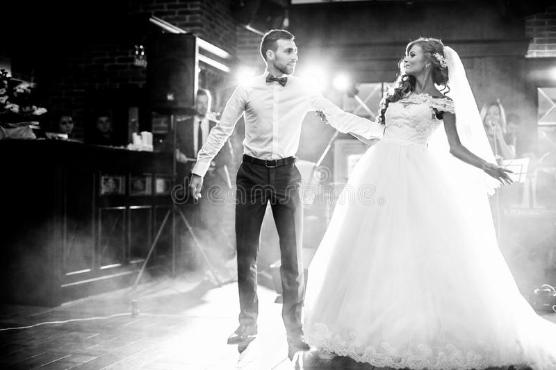 Beautiful newlywed couple first dance at wedding royalty free stock photography