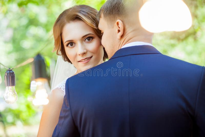 Beautiful newlyweds sensually hugging in park royalty free stock photos